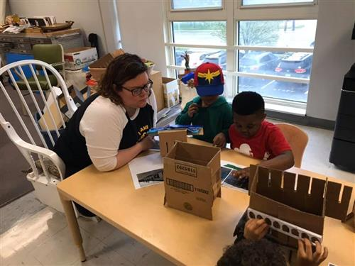 students make buildings with teacher