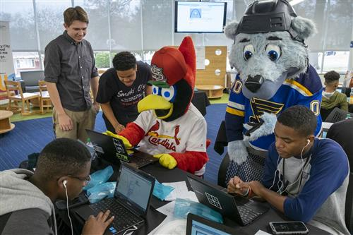 Fredbird and Louie help U City students learn coding at a special event on Dec. 3, 2018