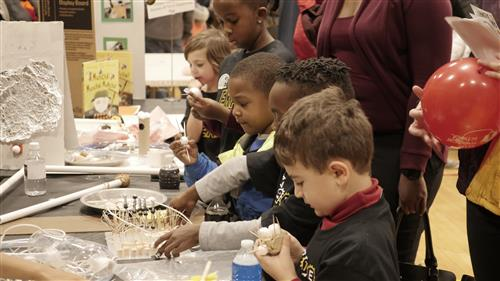 UCity Students Work Attentively during the STEM Expo