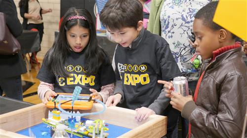 Students explore technology together at STEM EXPO.