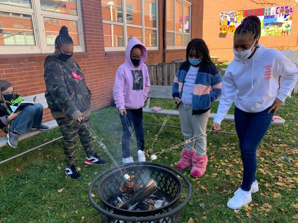 Brittany Woods students making s'mores.