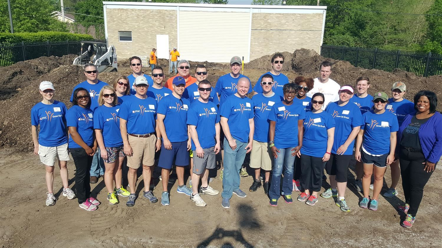 volunteers help build a playground