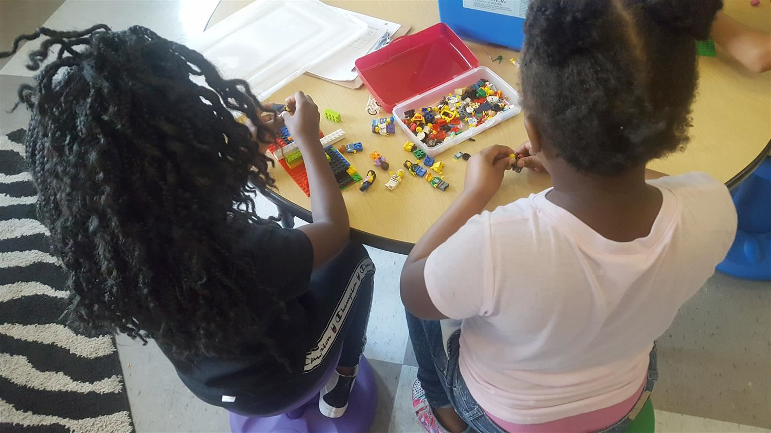 Girls working with legos