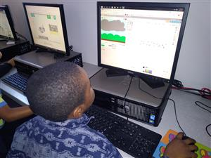 Student programming a storm simulation using Scratch